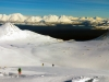 Ski touring up the mountain in the Lyngen Alps
