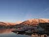 Sun set over the harbor in Tromso Norway